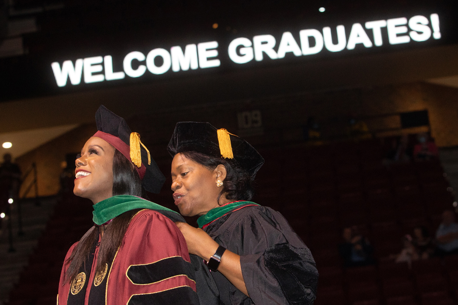 A graduate receives her her academic hood at the graduation ceremony for the Florida State University College of Medicine M.D. Class of 2021. (FSU Photography Services)