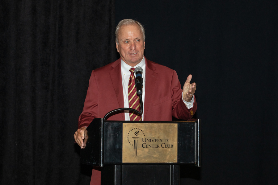 FSU Board of Trustees Chair Ed Burr celebrates President John Thrasher and FSU First Lady Jean Thrasher during a June 16 reception at the University Center Club. (FSU Photography Services)