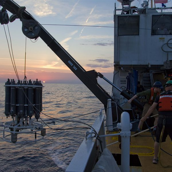 Researchers on the NOAA ship Nancy Foster recovering a CTD instrument that is used to collect water samples and algae from multiple depths in the ocean. (Courtesy of Michael Stukel)