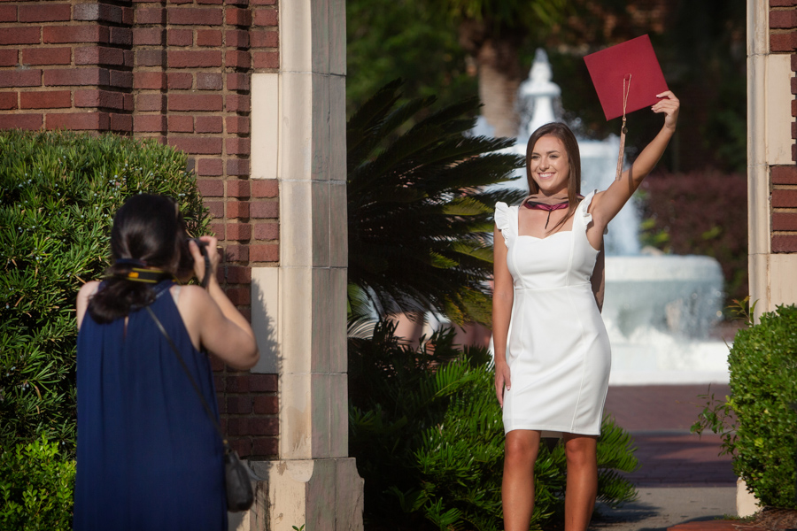 Summer graduates have photos taken in Westcott Plaza before this afternoon and this evening's commencement ceremonies. (FSU Photography Services)