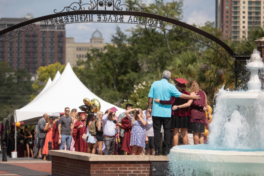 FSU graduates celebrate their farewell on Westcott Plaza after commencement ceremonies Friday at the Tucker Civic Center. (FSU Photography Services)