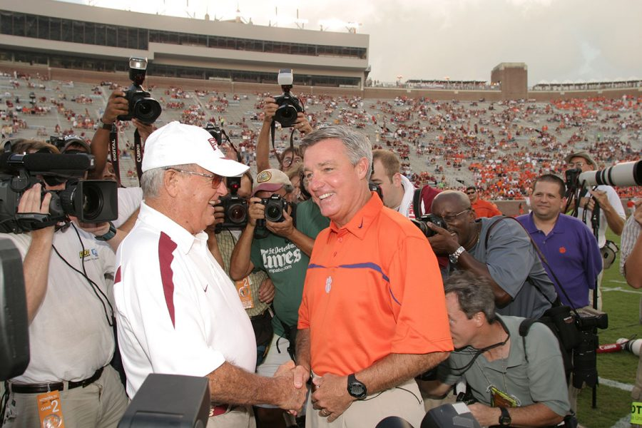 Coach Bobby Bowden shakes hands with his son Tommy, then-head coach of Clemson, before the 2006 Bowden Bowl. (FSU Photography Services)