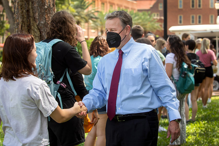 FSU President Richard McCullough greets students on Landis Green for the first day of fall semester Aug. 23, 2021 (FSU Photography Services).