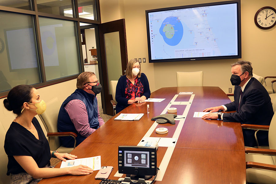President Richard McCullough meets with VP for Student Affairs Amy Hecht, VP for Finance and Administration Kyle Clark and Provost Sally McRorie about Tropical Storm Fred during his first day as FSU's 16th president. (FSU Photography Services)