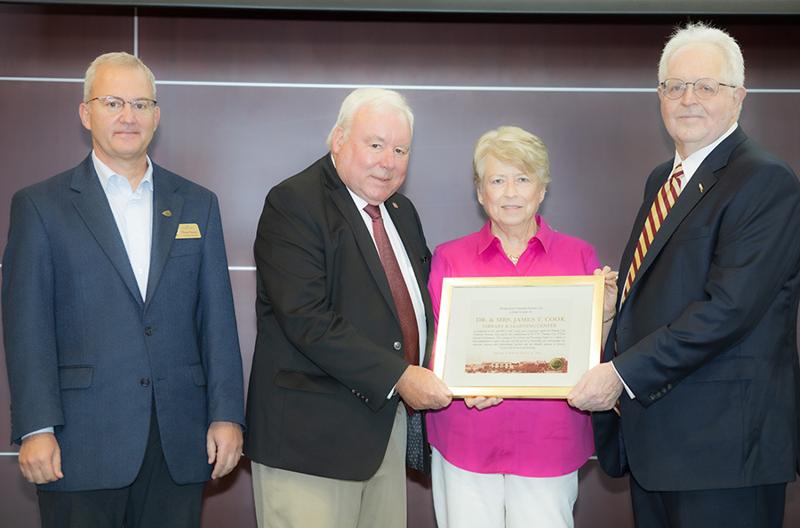 """(From L to R) FSU PC University Librarian Shaun Saxon, Dr. Jim and Jan Cook and FSU PC Dean Randy Hanna announcing the naming of the Library and Learning Center as the """"Dr. and Mrs. James T. Cook Library and Learning Center."""""""