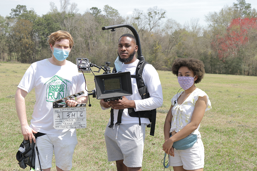 BFA Production Students pause for a photo on set. (FSU College of Motion Picture Arts)