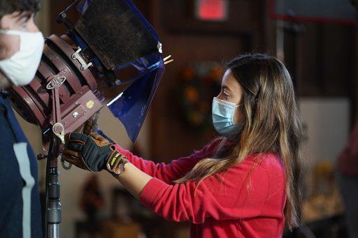 BFA Production Student Melissa Calderon rigs a light. (FSU College of Motion Picture Arts)