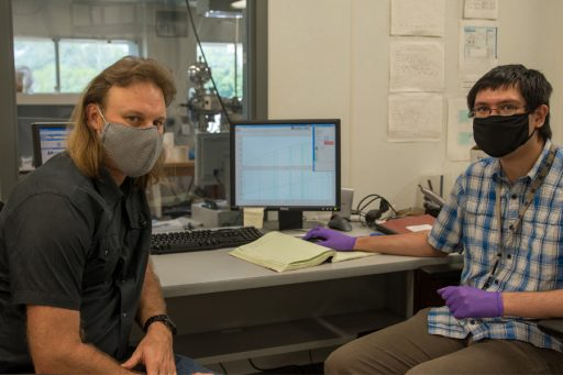 From left, Jeremy Owens, an associate professor in the Department of Earth, Ocean and Atmospheric Science, and Sean Newby, a graduate research assistant, analyzing thallium isotopes on instruments at the National High Magnetic Field Laboratory. (Stephen Bilenky / National High Magnetic Field Laboratory)