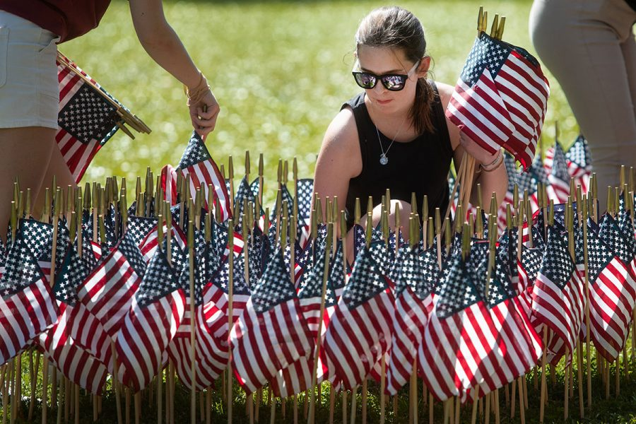 Veterans Student Union CFO Melanie Green helps set up a display on Mina Jo Powell Green to remember the lives lost in the Sept. 11 attacks.