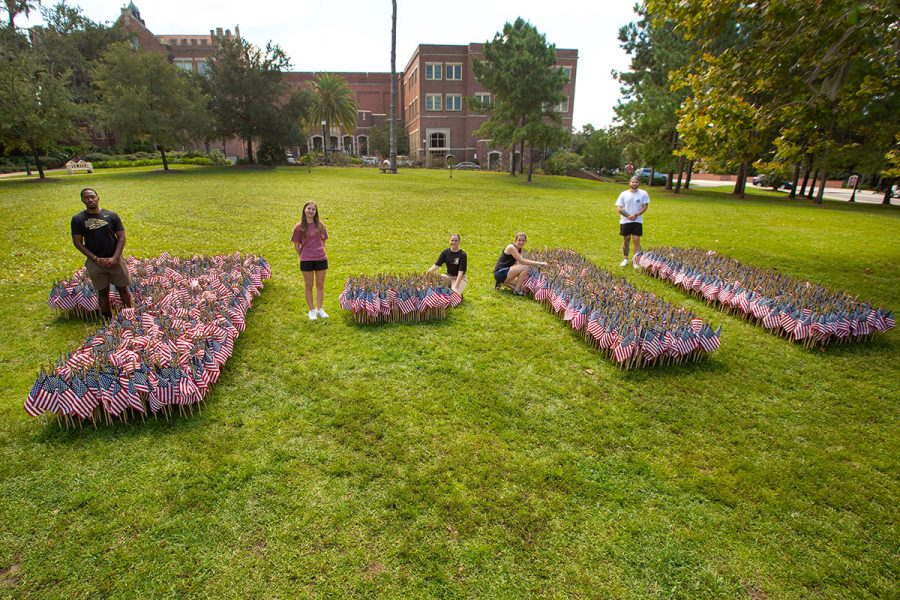 FSU students Cameron Bickley, Sarah Johnson, Haley Olsen, Melanie Green and Mitch Budihas helped create a flag display to honor the lives of those who died on Sept. 11, 2001.