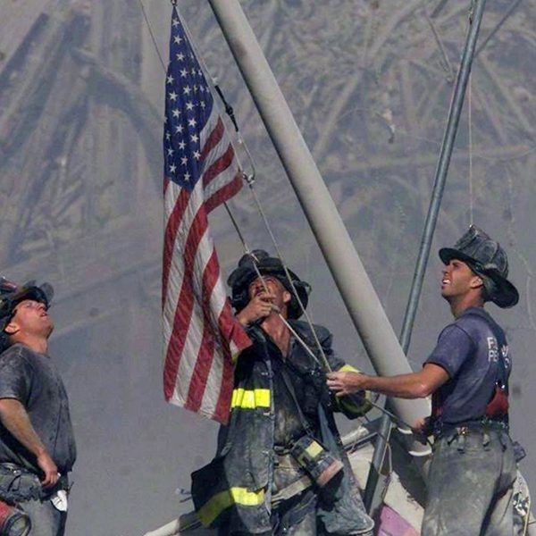 Three firefighters raise the U.S. flag on Sept. 11, 2001 at the World Trade Center in New York City. (Thomas E. Franklin/The Record)
