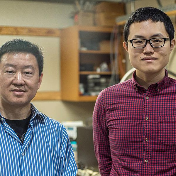 From left, Wei Guo, associate professor in mechanical engineering at the FAMU-FSU College of Engineering, and Toshiaki Kanai, a graduate research student working with Guo at the National High Magnetic Field Laboratory. (Photo by Stephen Bilenky/National MagLab)