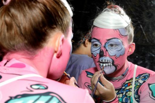 Maddie Hammer backstage doing her own pop zombie makeup for the opening dance routine.